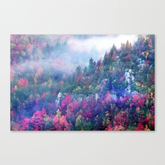 Fog over a colorful fall mountain forest Canvas Print