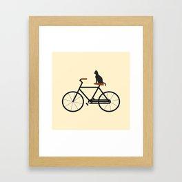 Cat Riding Bike Framed Art Print