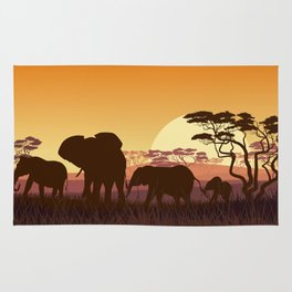 elephants in the African meadow Rug