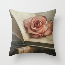 Still life with pink rose and old books Throw Pillow