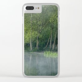 Photograph of mist on water, with woodland on the shore. Clear iPhone Case