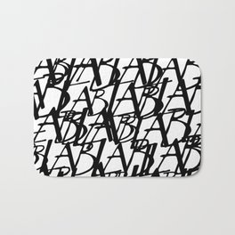 Abstract letter pattern on white background Bath Mat
