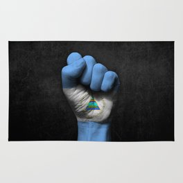 Nicaraguan Flag on a Raised Clenched Fist Rug