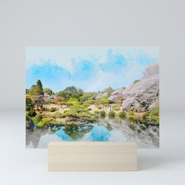 beautiful blossom sakura, pond and blue sky in spring time in Shinjuku Gyoen Park, tokyo Mini Art Print