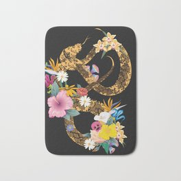 golden snake with flowers on black background Bath Mat
