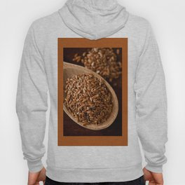 Brown flax seeds portion on wooden spoon Hoody