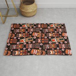 Haunted Halloween Tiki Luau in Black + Orange Rug