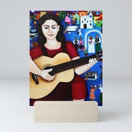 Violeta Parra and her guitar Mini Art Print