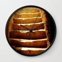 mandie manzano Wall Clocks featuring Steps to tomb by Brian Raggatt