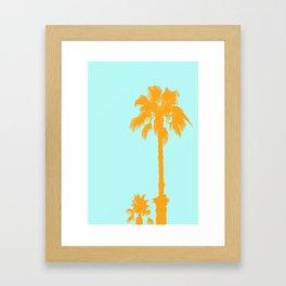 Orange palm trees silhouettes on blue Framed Art Print