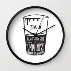 glass half full of emptiness Wall Clock