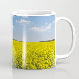 Path through blooming canola under a blue sky with clouds Coffee Mug