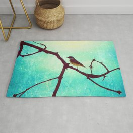 The Bird (Textured blue sky and little bird in a branch tree) Rug