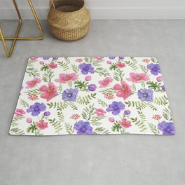 Seamless pattern of pink and purple meadow flowers on a white background. Rug