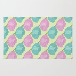 Purple and teal tulips on a mint green background Rug