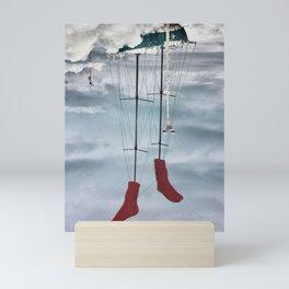 Floating up-side-down ship Mini Art Print