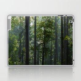 Green forest shrouded the sun. Laptop & iPad Skin