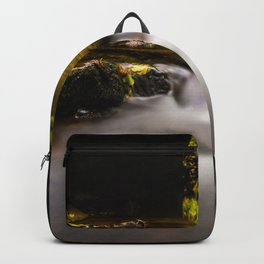 Easy flowing water in autumn Backpack