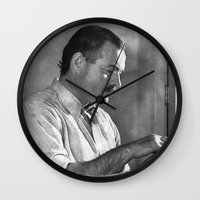 hemingway Wall Clocks featuring Ernest Hemingway  by Limitless Design