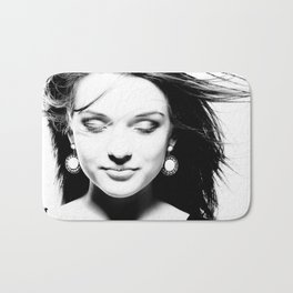 High contrast black and white portrait of beautiful girl with fluttering hair and closed eyes. Bath Mat
