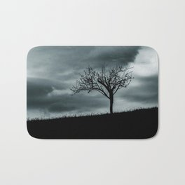 Alone tree before the storm Bath Mat