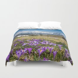 Mountains and crocus flowers on Velika Planina, Slovenia Duvet Cover