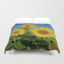 Large sunflower against blue sky in summer Duvet Cover