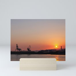 Sunset at an industrial harbour Mini Art Print