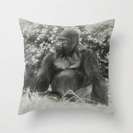 Male gorilla sitting on the ground Throw Pillow