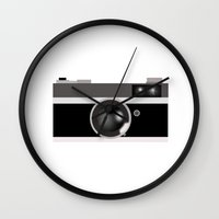 vintage camera Wall Clocks featuring Camera by LeahOwen