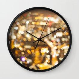Defocussed city at night Wall Clock