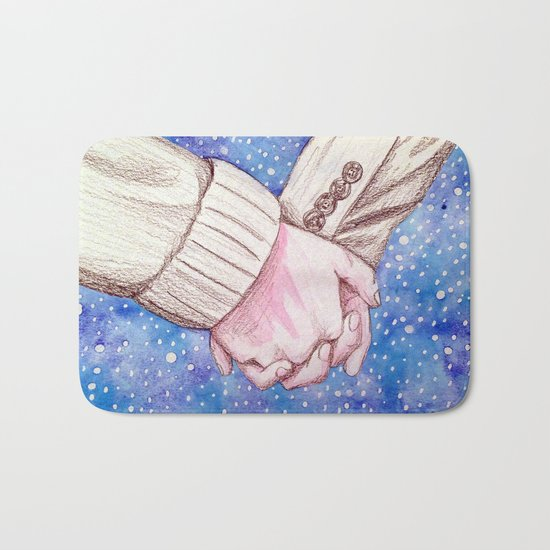 holding hands in the snow Bath Mat