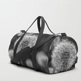 Monochromatic dandelion on black Duffle Bag
