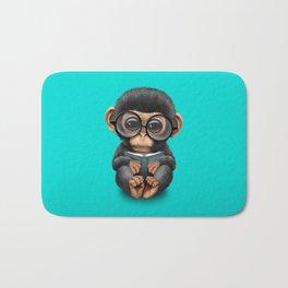 Cute Blue Baby Chimp Reading a Book Bath Mat