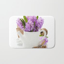 Beautiful Hyacinths in vase and garden tools Bath Mat