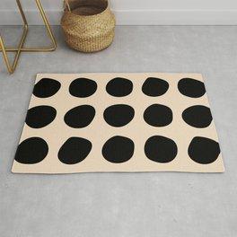 Irregular Polka Dots black and cream Rug