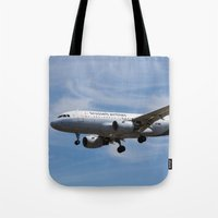brussels Tote Bags featuring Brussels airlines Airbus A319 by David Pyatt