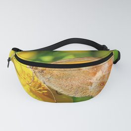 Fadet common butterfly pollination on silverweed flower Fanny Pack