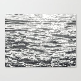 Glittering Early Sunlight Bouncing Off Gentle Waves in Monochrome Black and White Canvas Print