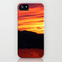 Sunset behind the mountains iPhone Case
