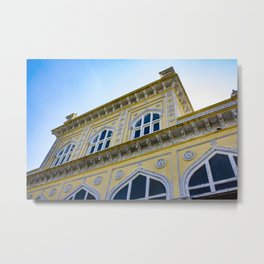 Blue Sky behind the front of the Yellow Chomahalla Palace in Hyderabad, India Metal Print