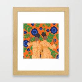 Black women in orange floral Framed Art Print