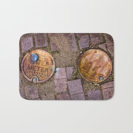 Water Meter Caps, from my street photography collection Bath Mat