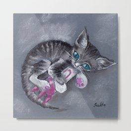 A kitten with blue eyes playing with a toy rocket Metal Print