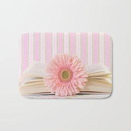 Pink flower on book (Retro Still Life Photography)  Bath Mat