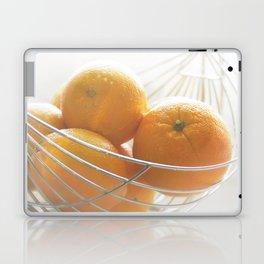 Fresh oranges in basket Laptop & iPad Skin