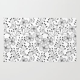 Doodle flowers in black and white Rug