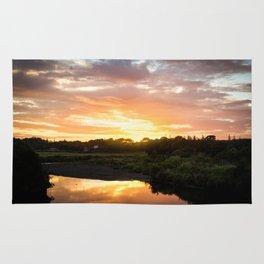 Sunrise over Waiwhakaiho River Rug