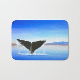 Whale tail on ocean with an island Bath Mat