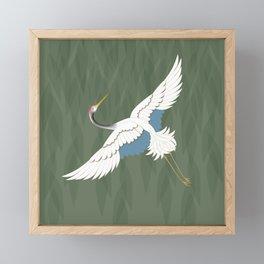 Flying crane and green leafs Framed Mini Art Print